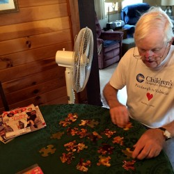 Dr. Ralph Siewers, a retired physician from Sedgwick, settles in with a jigsaw puzzle at The Vicarage by the Sea in South Harpswell.