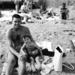 Sherry Sullivan (right) and her father, Geoffrey Francis Sullivan, pose for a picture during an outing at an unspecified beach in an undated family photograph.