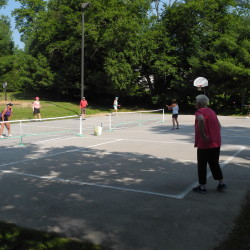 A group of people play pickleball on Thursday in Belfast. City councilors this week agreed to convert the dilapidated basketball court at Belfast City Park into a dedicated pickleball court.