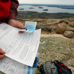 A conservation advocacy manager for the Appalachian Mountain Club fills out a visibility data sheet while on the North Ridge trial on Cadillac Mountain in this April 2004 file photo. The manager was checking ozone levels.