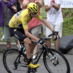 Race leader Chris Froome of Britain rides after a fall during the 19th stage of the Tour de France Friday from Albertville to Saint-Gervais Mont Blanc, France.