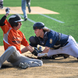 Adam Turcotte (left) of Skowhegan slides safely into home as catcher Derek Fournier of the Coffee News Comrades for Bangor reaches for the throw during a Zone 1 American Legion baseball tournament game on Friday night at Husson University's Winkin Complex.