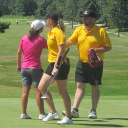 Bailey Plourde (center) heads off the green while Staci Creech (left) shakes hands with Plourde's father and caddie, Bob Plourde, after the first round of the Maine Women's Amateur Monday at Penobscot Valley Country Club in Orono.