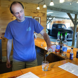 Keith Bodine pours a sample of Sweetgrass Farm Winery and Distillery's apple brandy in Union on Tuesday.