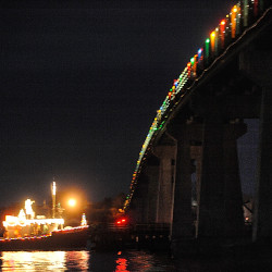 A lobster boat decorated with lights glides under the Beals Island Bridge in this 2009 photo. With the help of $10.5 million in federal funding, construction of a new bridge to replace the existing 1,000-foot span, which was built in 1958, is expected to begin in April 2017.