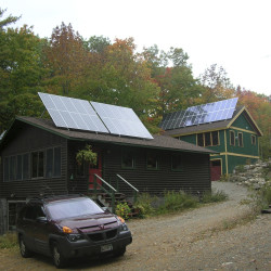Two arrays of solar panels sit atop the buildings at Williams Pond Lodge in Bucksport in this 2008 file photo.