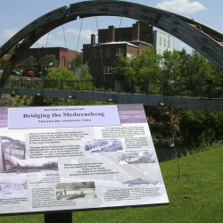 One of several storyboards that depict the history of Houlton is pictured near Gateway Crossing, the town's pedestrian footbridge in Riverfront Park in July 2009. The town is considering drafting an ordinance to ban smoking in the park due to an escalating issue with cigarette butts being left on the ground and in the picnic areas.