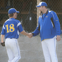 Hermon pitcher Nick Guerette (18) gets a congratulation from coach Matt Kinney during a game in Hermon in this May 2014 file photo. Kinney is also the head coach of the Bronco-Hermon All-Stars which will be competing in the Senior League World Series Sunday.
