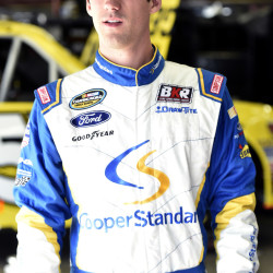 Fort Kent native Austin Theriault waits in the garage area during a practice at New Hampshire Motor Speedway in Loudon, New Hampshire, Sept. 25, 2015.