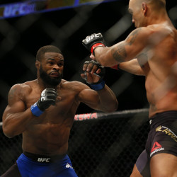 Tyron Woodley (left) battles Robbie Lawler for the world welterweight championship during UFC 201 at Phillips Arena in Atlanta on Saturday night. Woodley knocked out Lawler in the first round.