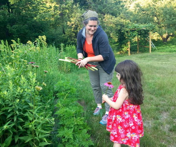 Margaret Hathaway picks flowers on her 17-acre property with her daughter, Sadie.