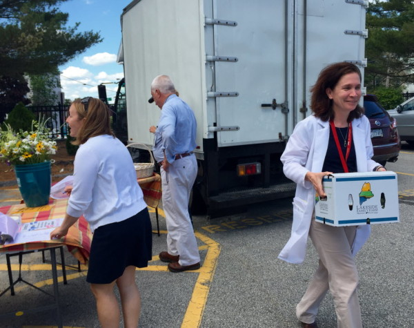 Dietitian Sharon Tate picks up a box of farm-fresh food outside Maine Medical on Thursday.