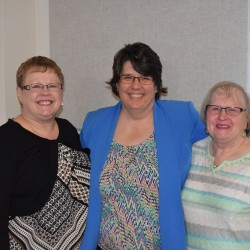 TAMC Interim President Glenda Dwyer thanks Vanda Cousins (left) and Annie Larrabee (right) for 40 years of service to TAMC.
