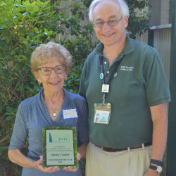 MDI Hospital President/CEO Art Blank congratulates Shirley Conklin on receiving MDI Hospital's 2016 Volunteer of the Year Award for her outstanding contributions to the MDI community.