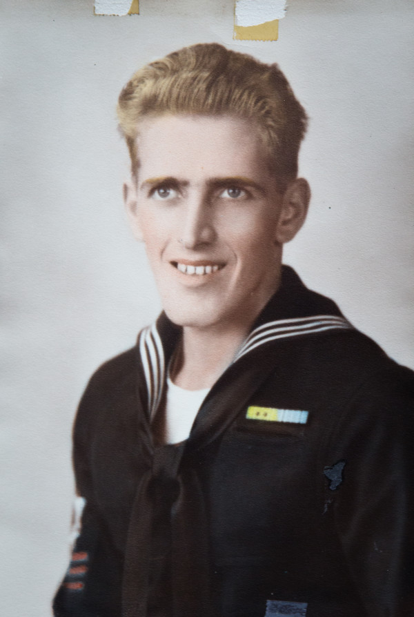 Will Jodrie, who died last week at the age of 93, smiles in the U.S. Navy uniform he wore while serving in World War II. Jodrie served in the South Pacific, including Australia and New Guinnea.