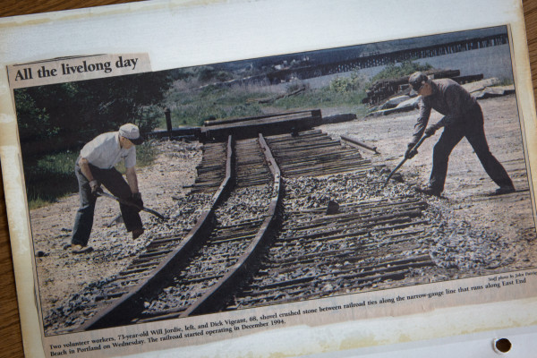 A 1996 newspaper clipping in a scrapbook shows a then 73-year-old Will Jodrie (left) laying track near the end of the Maine Narrow Gauge Railroad line on Portland''s East End. On Friday, Jodrie''s family chartered a special train, riding over those same tracks, taking his ashes to the end of the line before spreading them in Portland harbor.