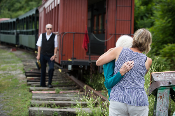 Sandy Jodrie (right) hugs her mother-in-law Gwendolyn Jodrie at the end of the Maine Narrow Gauge Railroad line in Portland on Friday as the family spreads Gwendolyn''s husband Will''s ashes on the harbor. They were married for 67 years.