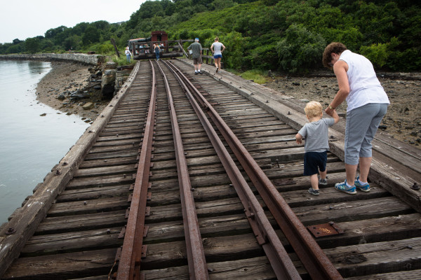Deborah Hilton holds her grandson Noah''s hand as they walk back to a Maine Narrow Gauge Railroad train in Portland on Friday. The family chartered a special train to the end of the line in honor of Will Jodrie, Hilton''s father, who died last week and was a former volunteer at the railroad.