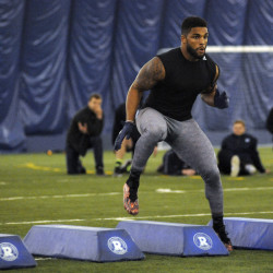 """University of Maine football player Trevor Bates runs a drill for NFL scouts during """"Pro Day"""" on March 21 in Mahaney Dome in Orono."""
