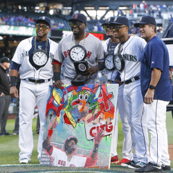Boston Red Sox designated hitter David Ortiz (34), Seattle Mariners designated hitter Nelson Cruz (23), starting pitcher Felix Hernandez (34, middle), second baseman Robinson Cano (22) and hitting coach Edgar Martinez (right) pose for a photo during a pregame ceremony honoring Ortiz's career Wednesday night at Safeco Field in Seattle.