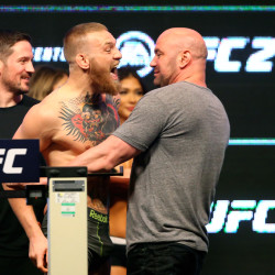 Conor McGregor (left) is held back by UFC president Dana White during weigh-ins for UFC 196 fight against Nate Diaz (not pictured) at MGM Grand Garden Arena in Las Vegas on March 4.