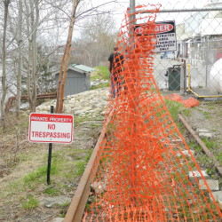 """A """"no trespassing"""" sign marks the southern terminus of the Belfast Rail Trail by the Penobscot McCrum potato processing plant. City officials would like to get an easement to connect the 2.3-mile Rail Trail with the Belfast Harbor Walk."""