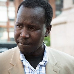 Kwan Malwal speaks to reporters in Portland''s Monument Square last month during a rally calling for peace in South Sudan. Malwal fled his home, escaping civil war, famine and genocide in 2002.