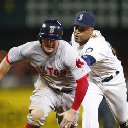 Seattle second baseman Robinson Cano (right) tags out Boston's Brock Holt during a rundown in the 11th inning of Thursday night's game at Safeco Field in Seattle. Boston won 3-2.