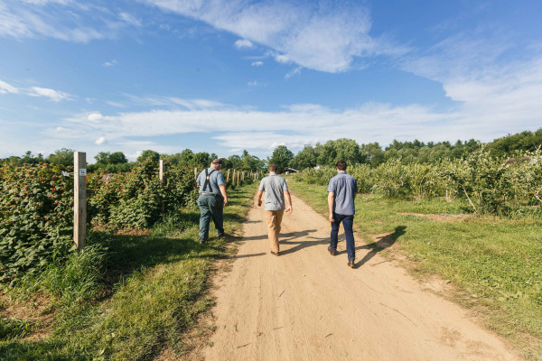Out to inspect the berries is Allagash Brewing Co. brewmaster Jason Perkins (middle) flanked by a farmer from Goss Berry Farm and Allagash employee Brett Willis.