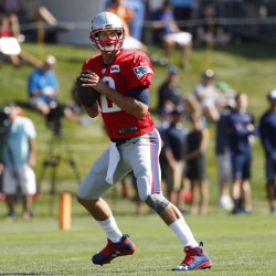New England Patriots quarterback Tom Brady looks for a receiver during training camp on July 30 at Gillette Stadium in Foxborough, Massachusetts.
