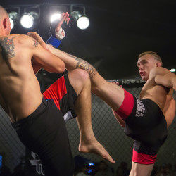 "Young's MMA's Josh Harvey (right) lands a kick to the face of Zenon Herrera during their featherweight bout as part of the reality program ""Dana White: Lookin' For A Fight"" event on Friday in the grand ballroom at the Cross Insurance Center in Bangor. Five Bangor-area fighters were on the card."