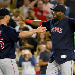 Boston Red Sox starting pitcher Steven Wright (left) is congratulated by Boston Red Sox designated hitter David Ortiz after throwing a complete game and defeating the Los Angeles Dodgers 9-0 Friday night at Dodger Stadium in Los Angeles.