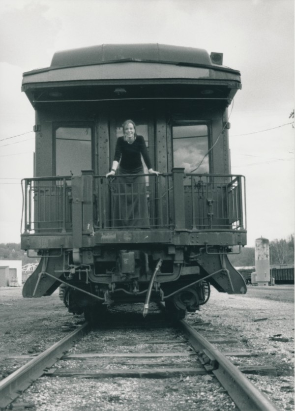 Former Maine resident Lindsey Bell aboard the Belford 99 railcar, which is now at a rail yard in Derby.