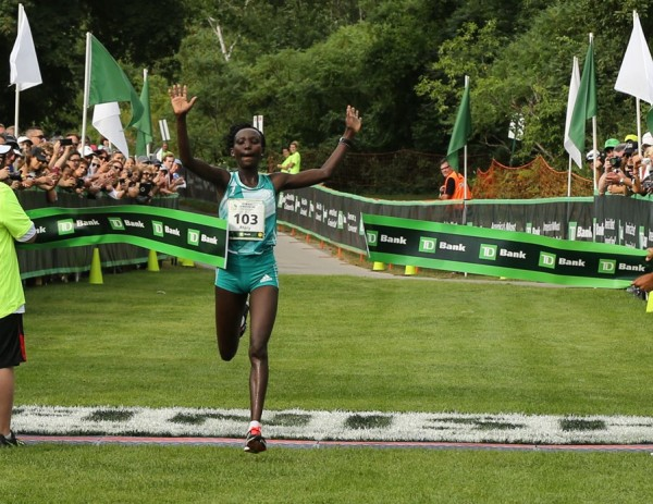 Mary Keitany of Kenya crosses the finish line to win the Elite Women''s division of the Beach to Beacon 10K with a time of 30 minutes, 45 seconds Saturday in Cape Elizabeth.