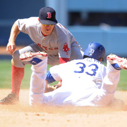 Los Angeles' Scott Van Slyke is caught stealing second in the sixth inning by Boston second baseman Brock Holt Saturday at Dodger Stadium in Los Angeles.