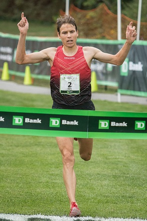 North Yarmouth native Ben True crosses the finish line to win the Beach to Beacon 10K road race Saturday in Cape Elizabeth with a time of 28 minutes, 16.3 seconds.