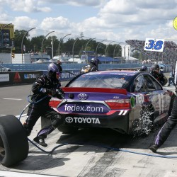 Sprint Cup Series driver Denny Hamlin (11) makes a pit stop during the Cheez-It 355 Sunday at Watkins Glen (N.Y.) International.