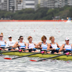 Team USA, including Boothbay Harbor's Elle Logan (second from the right), prepares to compete in the women's eight heats at Lagoa Stadium during the Rio 2016 Summer Olympic Games.