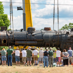 New England Steam Corp. begins the process of moving the locomotive Maine Central No. 470 to Hancock, where it hopes to refurbish it and put it back on the tracks, on Monday in Waterville.
