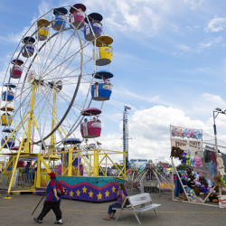 People walk around the Bangor State Fair at Bass Park in Bangor, July 30, 2016.