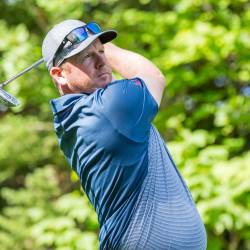 Falmouth Country Club's Shawn Warren watches his shot during the first round of the State of Maine Championship Tuesday at the Sugarloaf Golf Club in Carrabassett Valley.