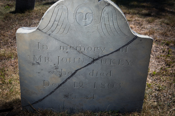 A stone marking the burial site of John Tukey bears the art of Portland stonecutter Bartlett Adams in the Eastern Cemetery on Monday. Adams also sold architectural stone and fruit trees in the early 19th century.