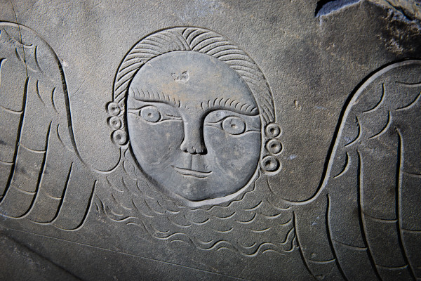 A winged face, carved in 1803, still stands on a slate tombstone in Portland's Eastern Cemetery on Monday. The city's first full-time carver, Bartlett Adams, made it for the grave of John Tukey.