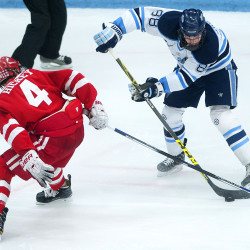 Boston University's Brandon Hickey (left) tries to steal the puck from University of Maine's Brian Morgan during their hockey game at Alfond Arena in Orono in this January 2016 file photo.