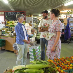 Ben and Taryn Marcus (right), owners of the Sheepscot General Store and Farm, share a laugh with customer Priscilla Donham of Alna. The unique general store, situated on a working organic farm, has become a community center since it opened in 2011.