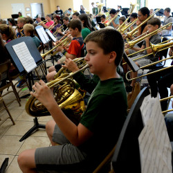 Spencer Gordon, who will be starting sixth grade in the fall, plays his french horn during rehearsal at Old Town's Band Camp on Thursday morning. The students learn five pieces in five days at the weeklong camp for fourth- to 12th-graders, ending with a concert Thursday evening at Hauck Auditorium at the University of Maine. This year marks the 20th anniversary of the popular camp that had 147 attendees this year.