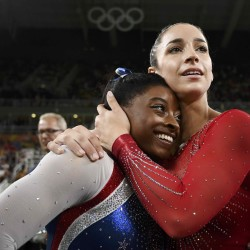 Simone Biles of USA (left) and Alexandra Raisman of USA celebrate winning gold and silver respectively at the women's individual all-around final.