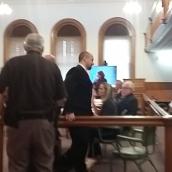 Matthew Davis, facing murder charges in the killings of Michael Kitchen and Heidi Pratt in Oakfield in 2013, enters a hearing in Aroostook County Superior Court.
