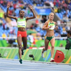 Almaz Ayana (left) of Ethiopia reacts as she crosses the finish line in the women's 10000-meter final Friday at Estadio Olimpico Joao Havelange during the  Rio Summer Olympic Games.