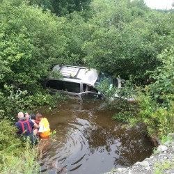 Two adults and three children were taken to a Bangor hospital Saturday for treatment of injuries they suffered when the van they were riding in left Route 155, crashed through a guardrail and plunged into a pond.